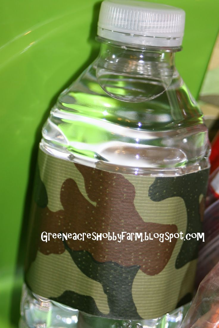 camoouflage duck pinata | wrapped some water bottles in camo duck tape to match the theme.