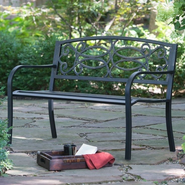 Transform your outdoor space into an elegant garden scene with the Scroll Curved Back 4 Ft Metal Garden Bench. Sturdily crafted of solid metal, reinforced by a powder-coated, tubular steel frame, this traditional outdoor bench is accented by intricate scrolls and a blackened finish polished in weathered bronze.