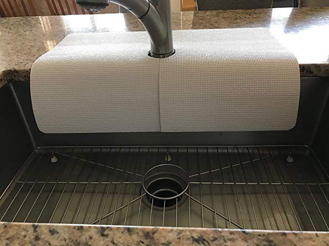 white kitchen sink faucet water splash