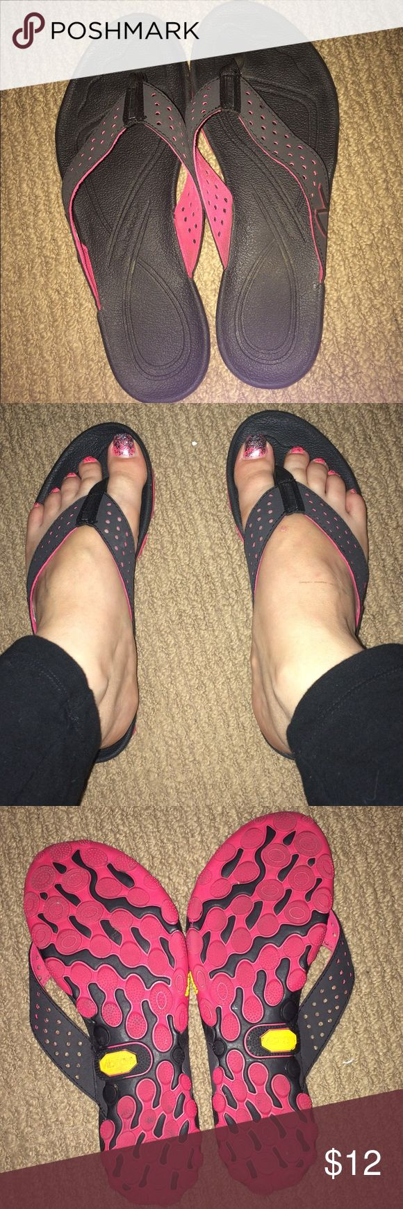 👡New Balance Flip flop sandals - black size 7 Only wore 2-3 times. Great Condition! All Black New Balance sandals. The bottom is a deep pink color. Size 7. Comfortable sandals New Balance Shoes Sandals