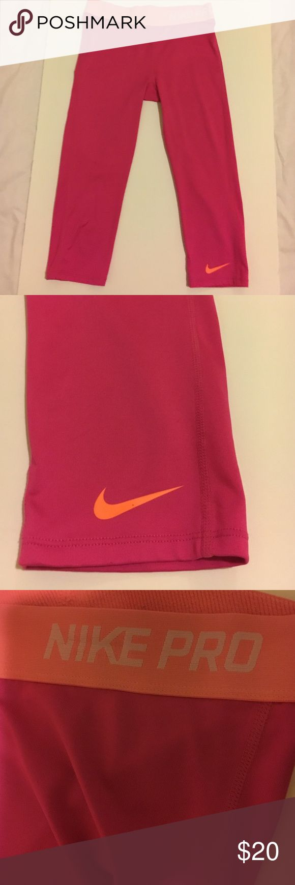 Nike Pro Pink Capri Size Large Girls Shows minimal signs of use. Worn it 2 or 3 times. This is a girls size. It would fit a xs size in women's. Waist is about 24in. Open to offers. Nike Bottoms Leggings