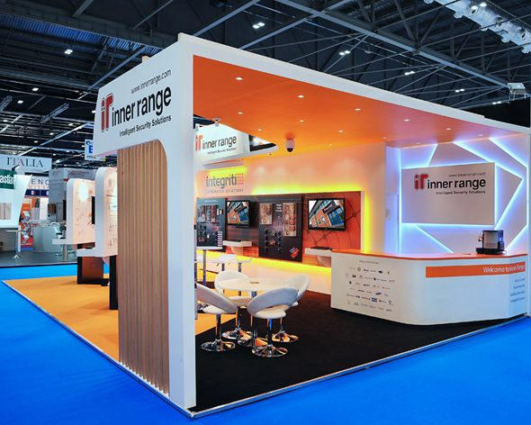Exhibition Stand Reception : I like the use of light behind the reception counter booth expo
