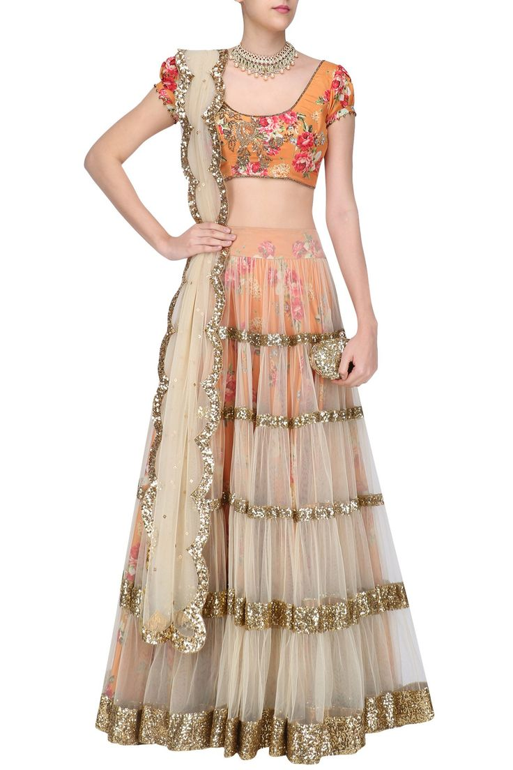 Beige lehenga skirt and orange floral embroidered blouse set available only at Pernia's Pop Up Shop.