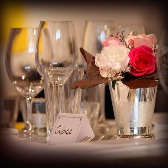 Perfect glassware and silver vases filled with roses and peonies.