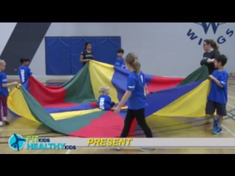 Present Wrap them up like a present and spin them like a top with this fun parachute game!