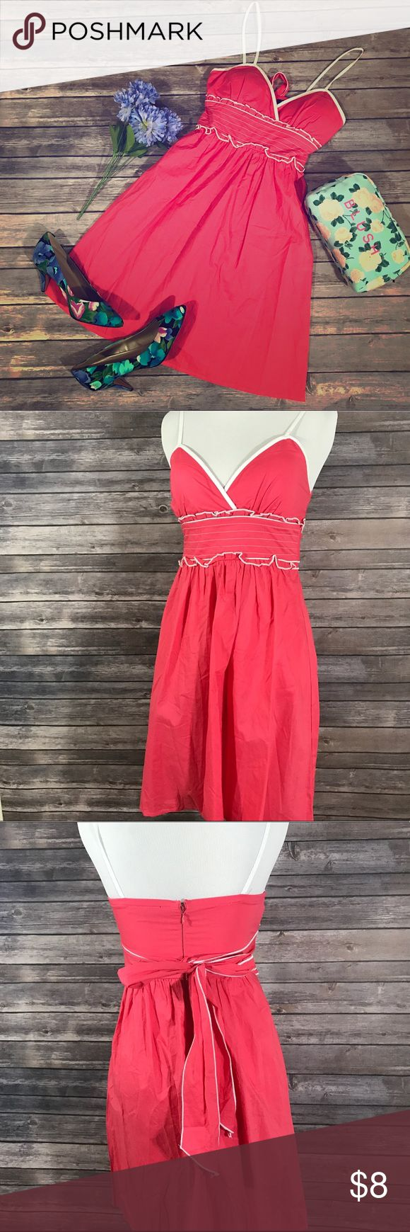 Bright pink sundress Lightly padded bright pink sundress with a cute tie back. No holes or stains in good condition. Dresses Mini