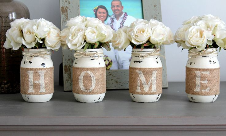 Mason jar décor is an extremely popular option for accenting homes that feature shabby farmhouse themes. This particular set of rustic table centerpieces feature pint sized Mason jars expertly hand pa