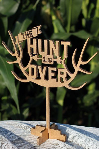 "The Hunt is Over!! This topper measures 8 1/2"" x 9"". It is shown in a rusty copper and soft gold in photos.  All our cake toppers are made out of 1/4″ hardwood for a smooth finish. They can be bought painted in a color of your choice or in a natural wood. We finish them with a food safe coating. Even though we call them cake toppers they can be used in floral arrangements, centerpieces, wreaths, or as a table top decoration. Wedding, hunting, camo, bridal shower, rustic, antlers, deer…"