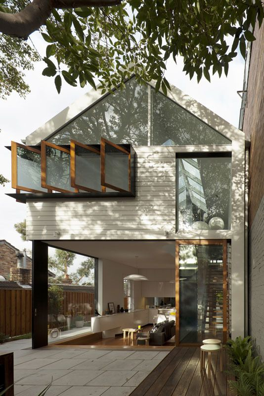 The rear of the Chistopher Polly-designed Elliott Ripper house shows the most impactful design moves: Windows that allow light and air to enter the house.