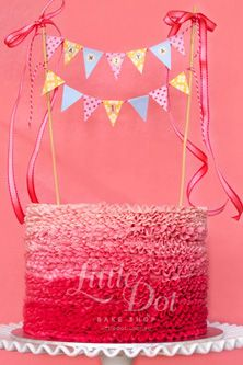 Little Dot Frilled Pink Ombre Cake with matching coloured layers inside and handmade paper craft bunting