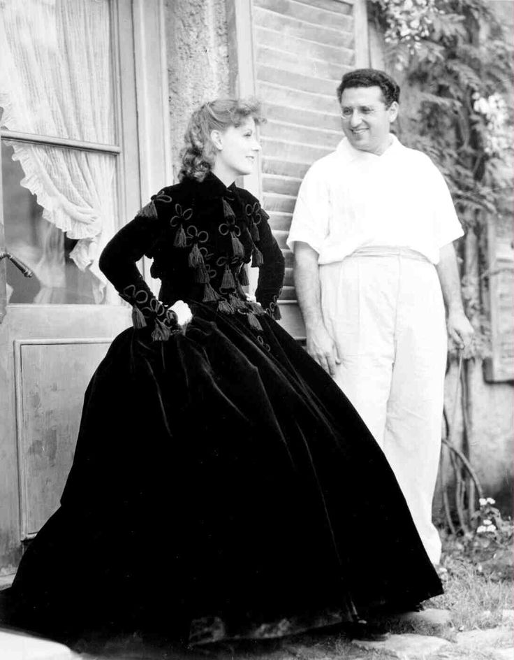 Full BTS shot of Greta Garbo as Marguerite Gautier (Camille) and director George Cukor.