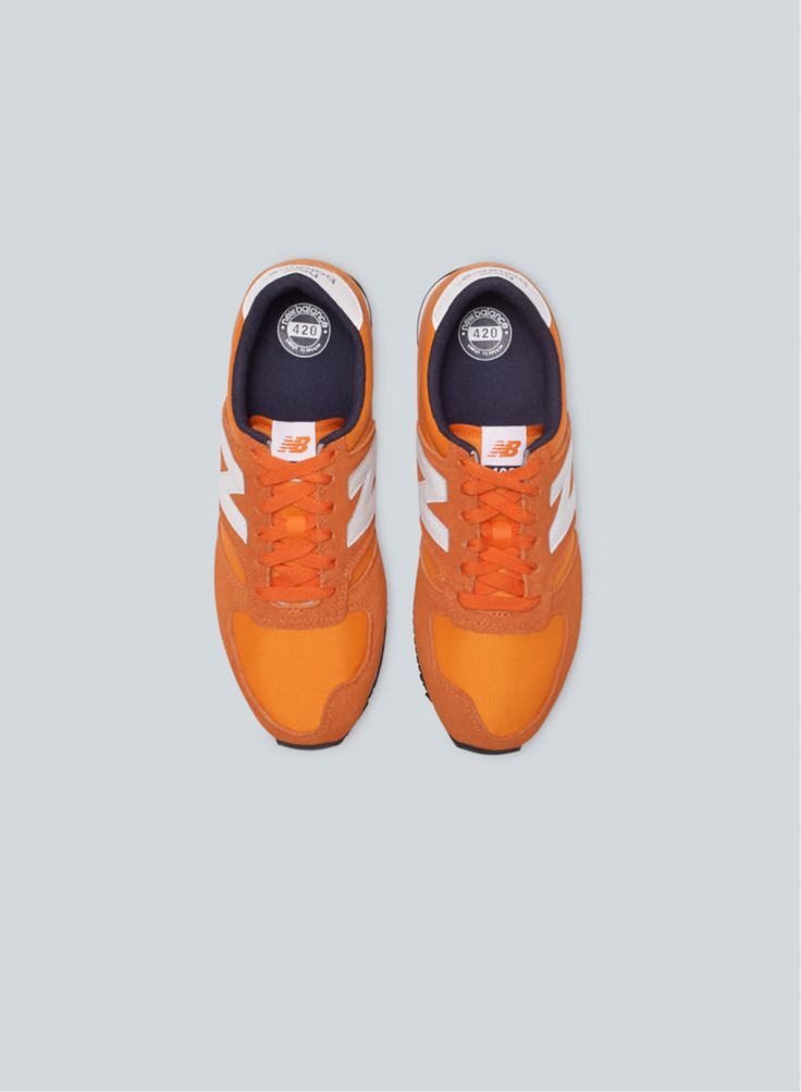 New Balance 420 Sneaker, now available at Aritzia. The #tangerine colour of these is everything.