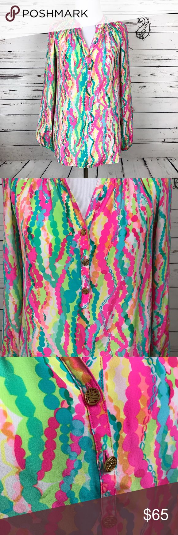 Lilly Pulitzer Elsa 100% Silk Long Sleeve Resort Signature Lilly Pulitzer top with split neckline and partial button front. Buttons are gold. Long blouson elasticized sleeves. 100% silk . Dry cleaned only. Size XS. Smocking around neckline. Sizing chart in pics . Lilly Pulitzer Tops Blouses