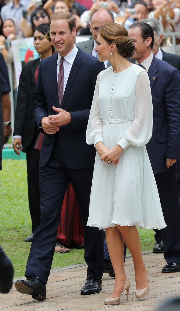 She wore a sheer-sleeved Beulah London dress in Kuala Lumpur.