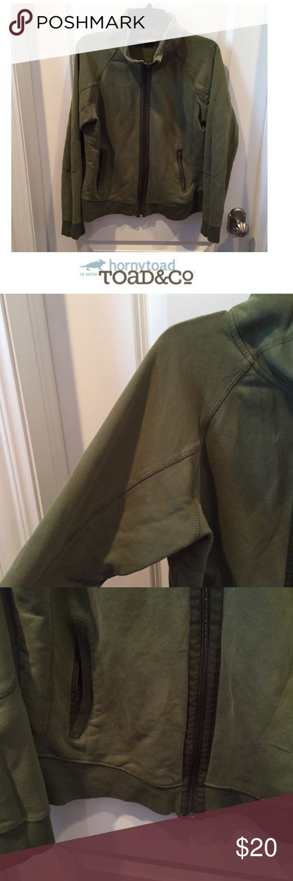 """Horny Toad Organic Cotton Green Zip Up Sweatshirt Horny Toad Organic Cotton Green Zip Up Sweatshirt. 20"""" bust. 23"""" long. Gently worn. Good condition. Color is a distressed green by design. Front Zip pockets. Feel free to make an offer or bundle & save! Horny Toad Tops Sweatshirts & Hoodies"""