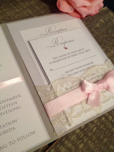 Lace Pocket Invitation Set shown in Soft Gray. Blush Pink and Vintage Ivory from…