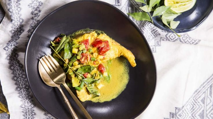 Fish curry with turmeric, ginger and curry leaves