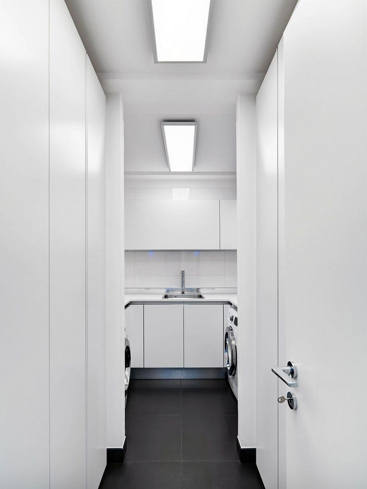 Apartments:Small Space Laundry Room Design With White Interior Design With White Doors Also White Cabinets Also White Wall Also Charm Lighting As Well As Black Ceramics Floor In Modern Italian Apartment Modern Interior Design of Luxury Apartment in Milan To Inspire You