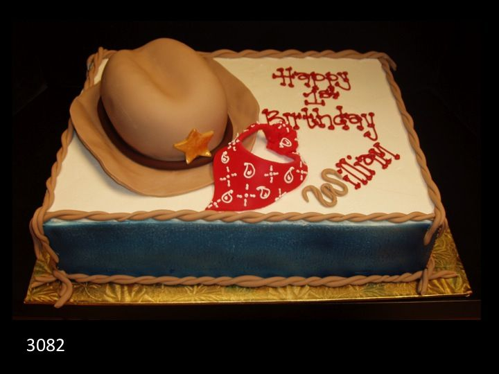 Cowboy birthday cake with cowboy hat and bandana