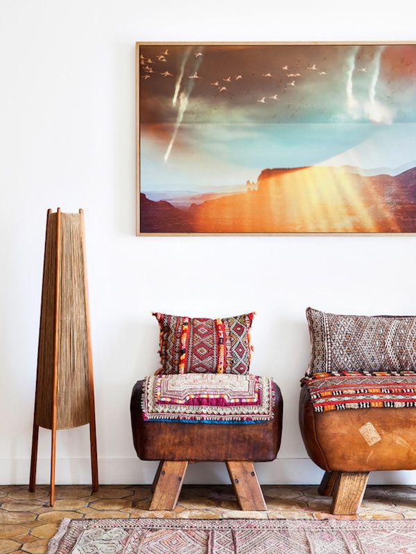 A beautiful bohemian retreat in Marseille | my scandinavian home | Bloglovin' - ok these stools are SUPER rustic, but i like that they are just stools up against the wall with pillows propped on them to create seating! a cool couch alternative maybe?
