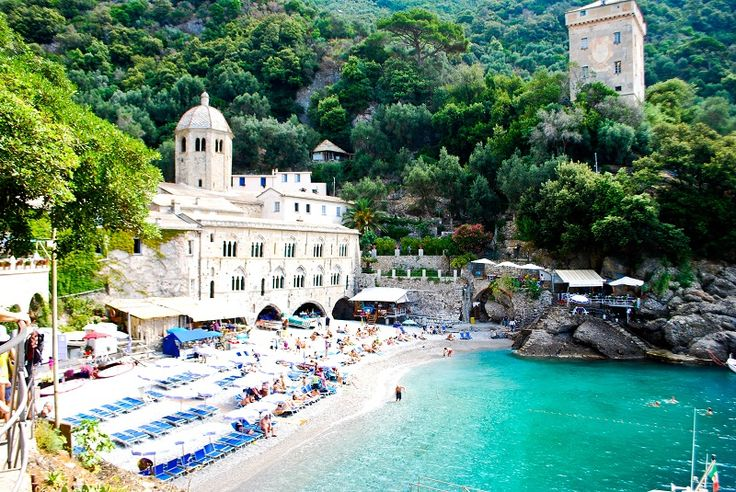 San Fruttuoso, Italy - only accessible by hiking or a boat ride from Camogli or Santa Margherita. In the background is an ancient Benedictine monastery.