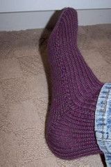 This pattern is written out step by step and has many photos to help you out. Even a beginner machine knitter can knit these socks. The pattern is written for the single bed mid-guage 6.5 machine, but there are notes for adjusting the pattern for the standard 4.5 machine. Happy knitting!!