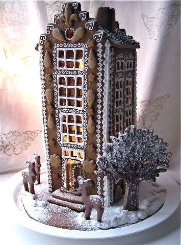 I like the cut out pieces of gingerbread decorating the front!