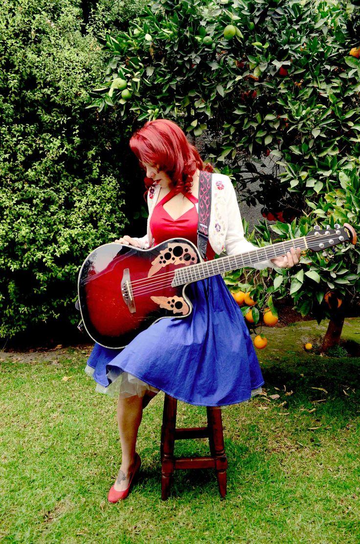 flat skirt, red top. White cardigan #rockabilly #rockabillyband #vintagehair #redhaired