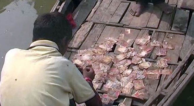 Rs 500/1000 notes found swimming in Ganga River at Mirzapur in Uttar Pradesh   A day after sacks full of shredded Rs. 500 and Rs. 1000 currency notes were found burning in Bareilly hundreds of similar notes were found floating in the Ganga river in Uttar Pradeshs Mirzapur on Friday.  The UP Police said they were not sure about the exact number of the currency notes floating in the river. They were spotted by people bathing in Ganga near Narghat.  As the news of currency floating in the river…