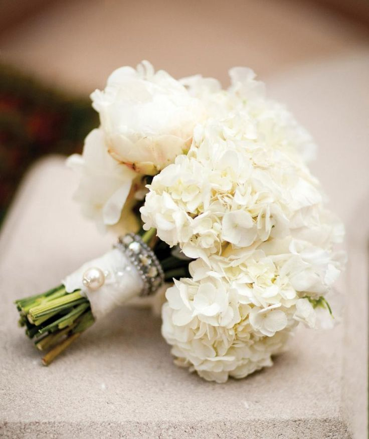 Gorgeous white hydrangea wedding bouquet with rhinestone & pearl details. Via ModWedding