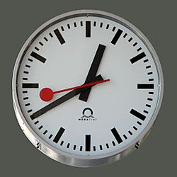 Swiss station clock. The second hand runs slightly fast then stops at the top for 2 seconds, making it easier for the trains to run EXACTLY on time.