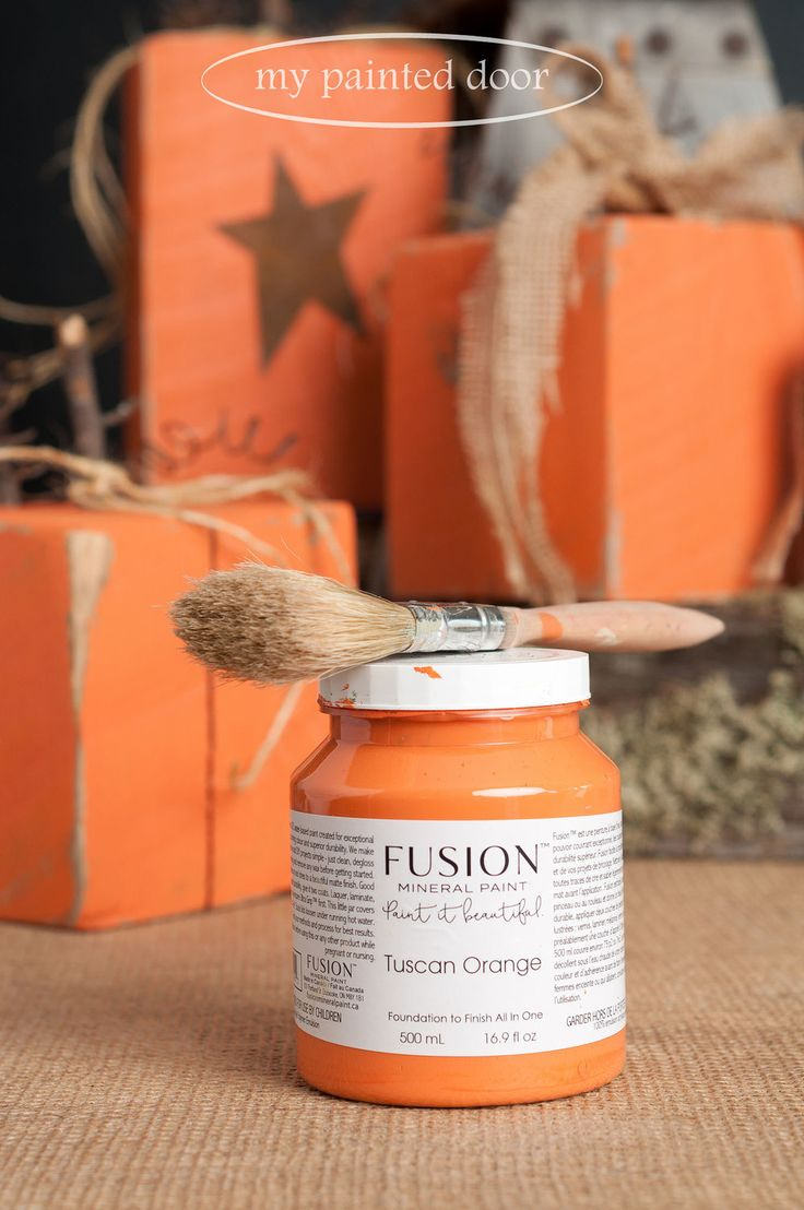 Rustic wood pumpkins painted in Tuscan Orange Fusion Mineral Paint.