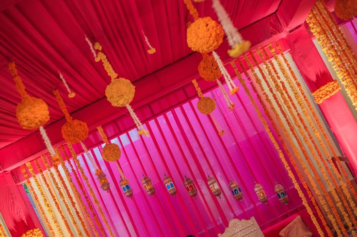 Traditional prop decor for the vedi (mandap). Indian wedding. Marigold (genda) floral.