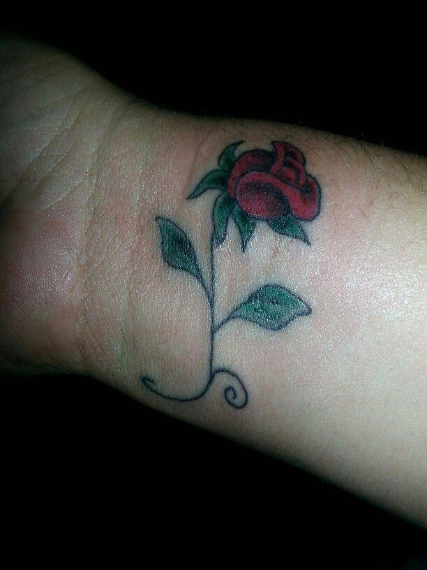 Small rose tattoo on the wrist