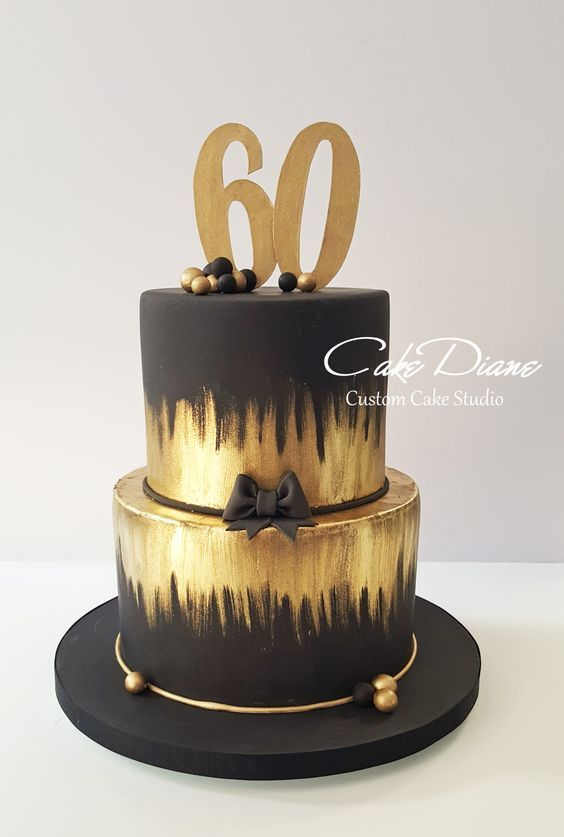 Black and gold cake for a man's 60th birthday.: