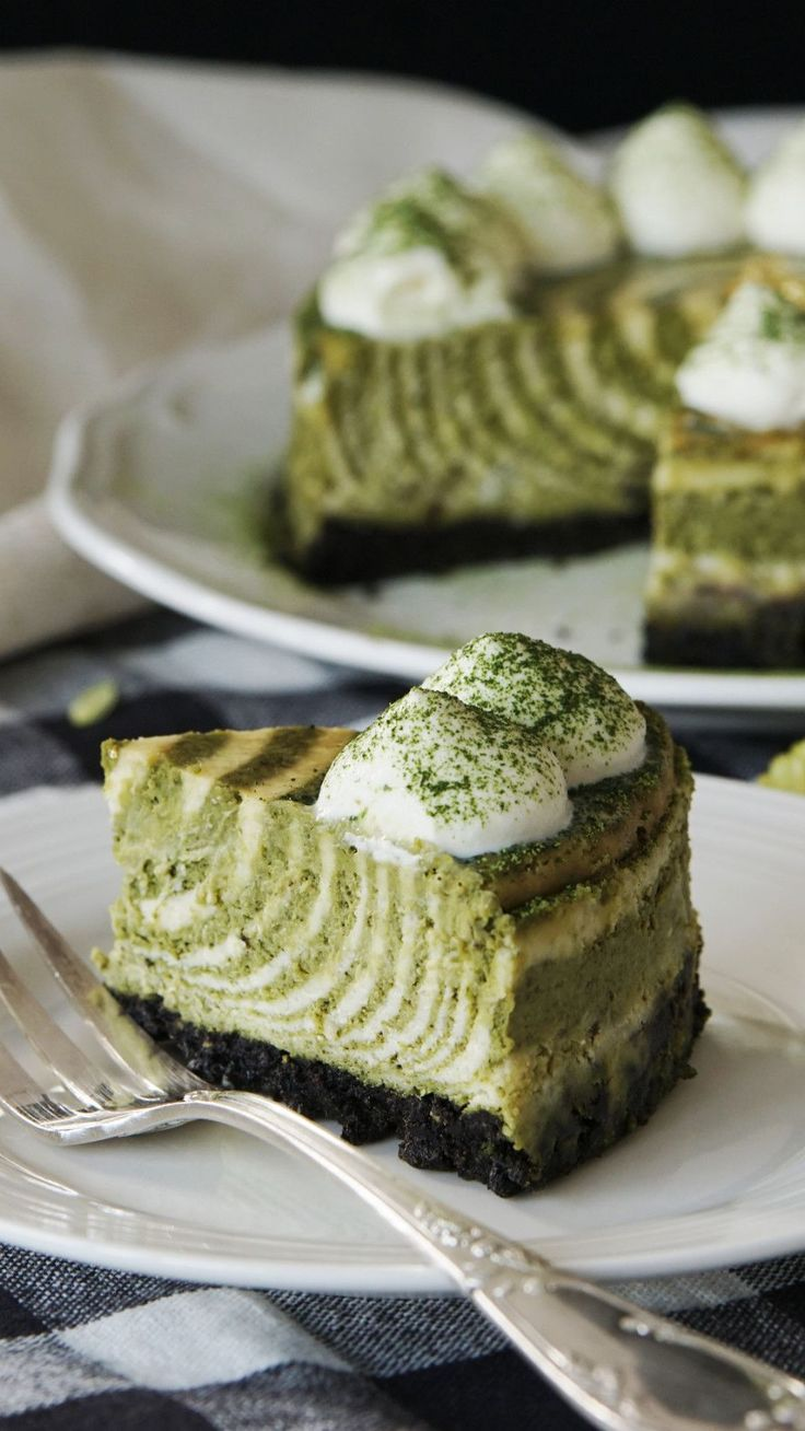 Recipe with video instructions: How to make matcha zebra cheesecake.  Ingredients: 10 matcha oreo cookies, 40g butter, melted, (filling), 200g cream cheese, 100g granulated sugar, 90g sour cream, 200g heavy cream, 3 eggs, 2 tbsp cornstarch, 10g matcha powder, (decoration), sweetened whipped cream, gold leaf