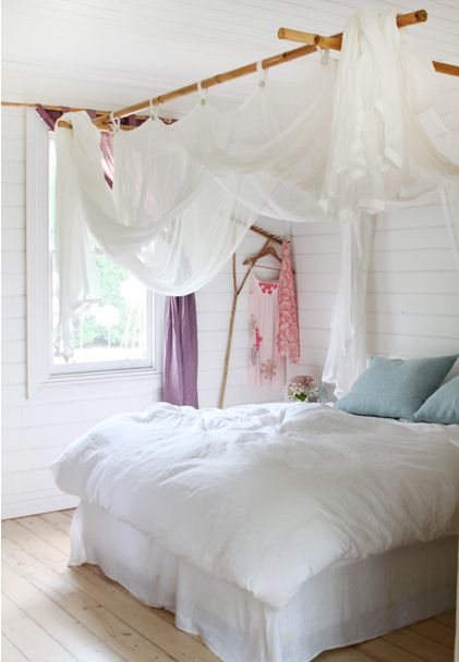 """bamboo curtain rods make easy """" canopy bed """" with sheers or mosquito netting"""