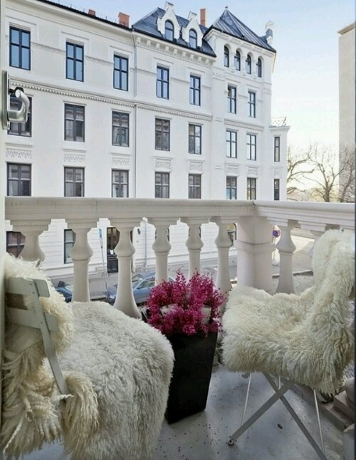 Sheepskin on outdoor chairs.
