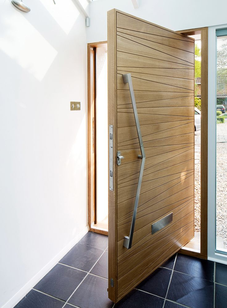 Pale Wooden Pivot Door From Urban Front Modern Entrance