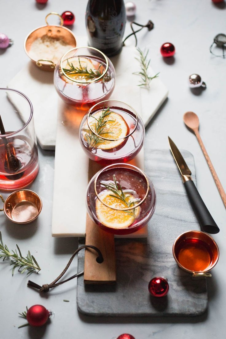 Cranberry Orange Champagne Mimosa with Candied Rosemary  /