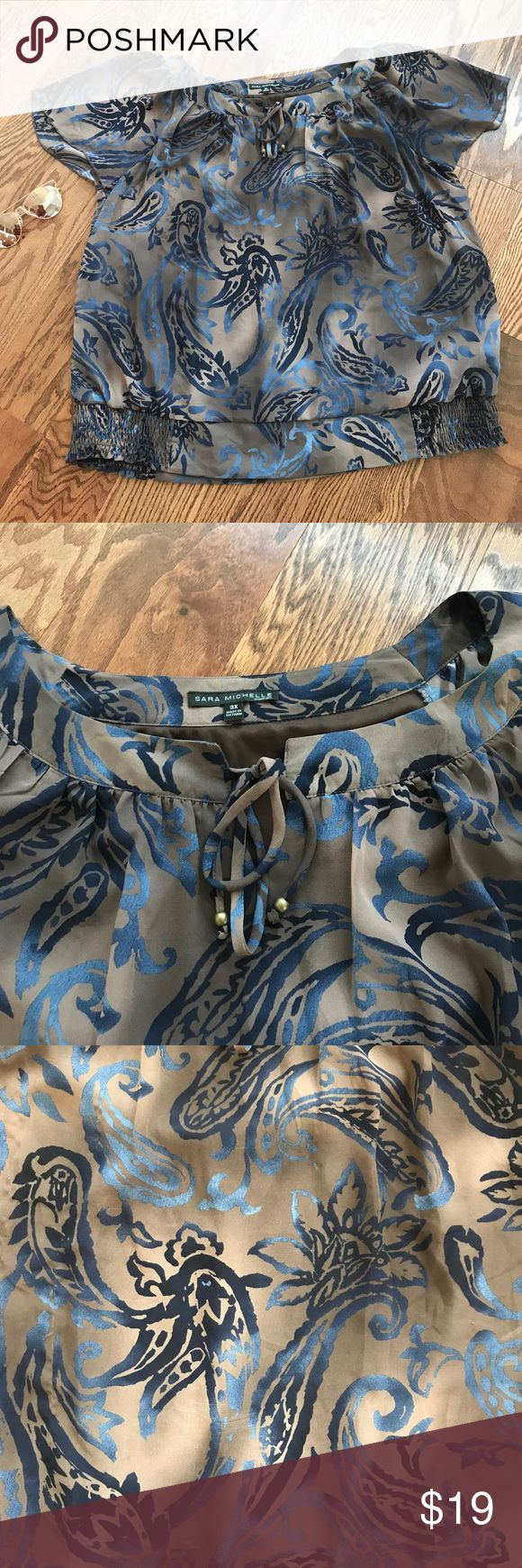 """Like new Sara Michelle blouse ! Pre-Owned. Great Condition. No Stains, Snags or Holes. Pet & Smoke-Free Home.  Brand: Sara Michelle Size: 3X Size Type: Plus Color: Brown, Tan, Blue Sleeve Style: Short Sleeve Measurements: Bust 54"""", Waist 54"""", Hips 58"""", Length 31"""" sara michelle Tops Blouses"""