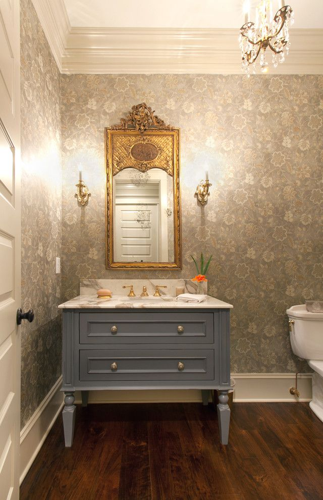 brickman group Traditional Bathroom Decorating ideas Charleston baseboards beige trim chandelier crown molding dark wood flooring freestanding vanity vabinet gold frame rectangular framed mirror wall sconce Wallpaper white ceiling white countertop