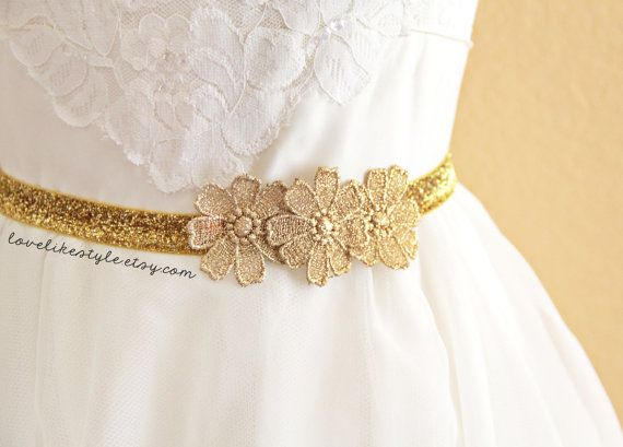 This is simple gold skinny elastic belt with gold flower lace. Made of 5/8 gold glitter elastic, gold metallic flower lace and brass hook. Unique