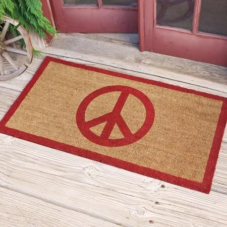 """$35 - $45 PEACE DOORMAT - Greet all comers with the welcoming message of our coir peace sign doormat.  What better symbol for the season than the iconic peace sign, emblazoned in red on durable natural coir fibers from coconut palms, thickly tufted on a tough PVC backing. Imported. Exclusive. 24""""W x 36""""L or 24""""W x 46""""L. HTG likes this in either sz tho the larger might feel more like an entrance mat?"""