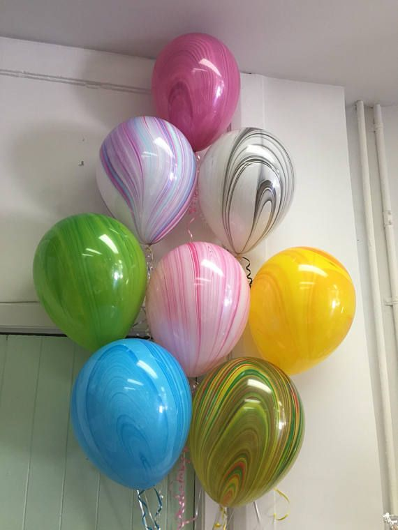 Pack of 10 latex marble balloons chose from Starting from top Cerise, unicorn rainbow, black and white, green, raspberry ripple, yellow, blue or multi. Or choose mixed pack. Comes with 10 x 2 metre colour coordinating curling ribbon. Ships flat. These can be air filled (will not float) or helium filled. For helium take to your local party store for inflation or purchase a small helium tank. With helium floating time is approx 12 hours or add hifloat for approx 3 days floating time. Ships…