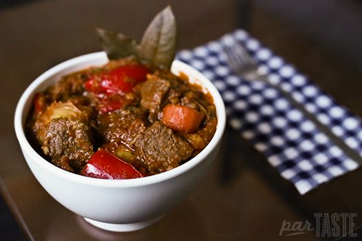 Slow-cooked beef in a tangy tomato sauce with potatoes and carrots, beef mechado is irresistibly flavorful and juicy.