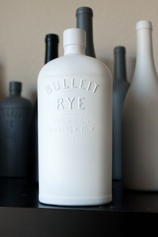 Repurpose Booze Bottles by painting white... love this!