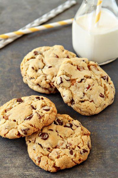 Turtle Cookies. Made with cake flour, bread flour, baking soda, baking powder, kosher salt, butter, light brown sugar, sugar, eggs, vanilla extract, dark chocolate chips, caramel bits, and chopped pecans.