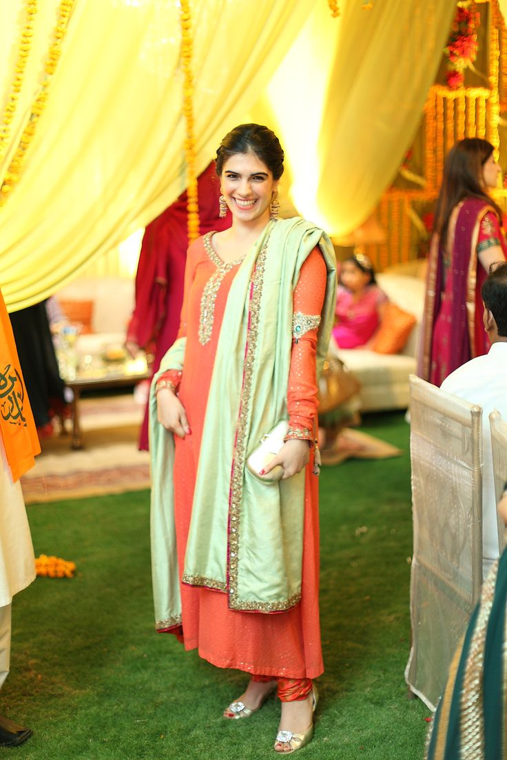 Peachy-coral w/ a light jade green dupatta. Love the red details.