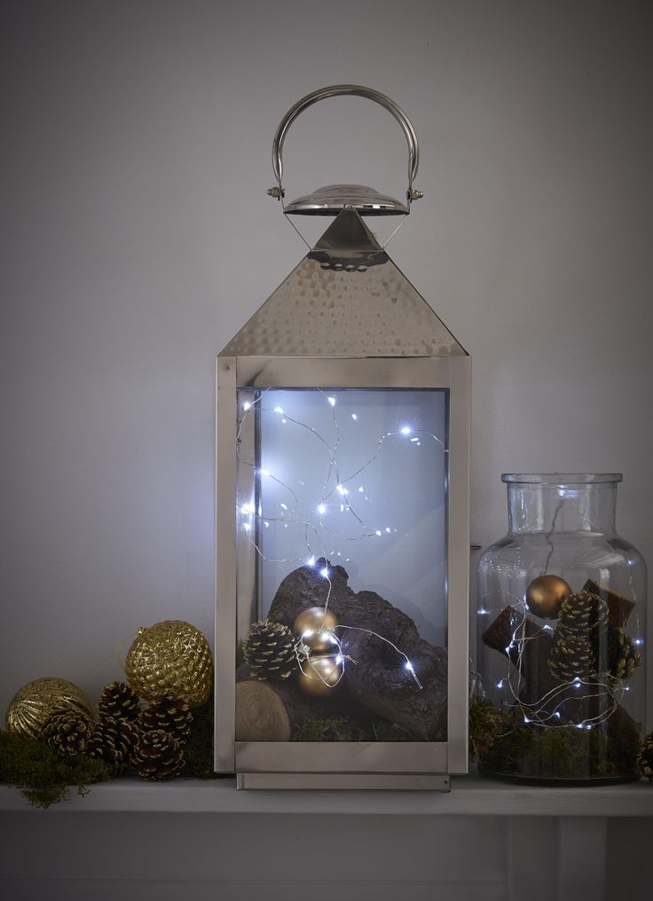 Twinkly fairy lights placed within a tall lantern provide the essential low lighting for a hyggelig home.